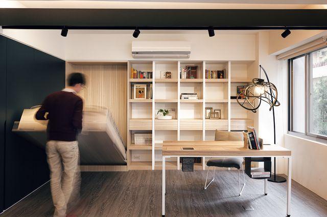 скандинавский интерьер гостиной со складывающимся спальным местом