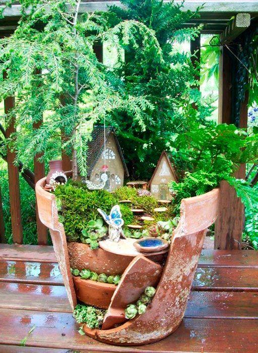 миниатюрный сад в разбитых горшках