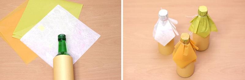 как упаковать бутылку в два листа бумаги 03