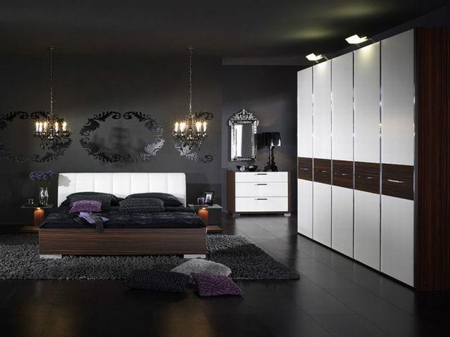 дизайн интерьера спальни в темных оттенках с белыми акцентами