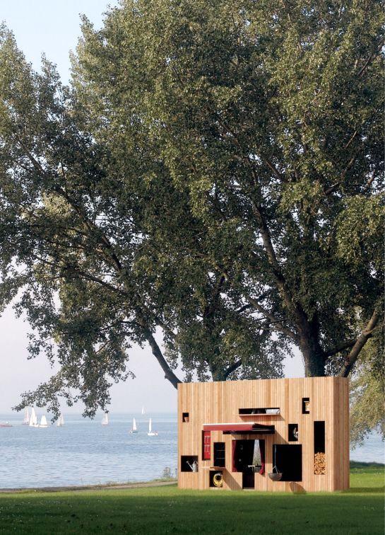 узкий летний домик Walden из дерева