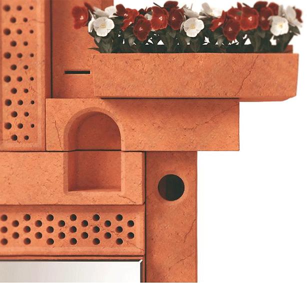 декор фасада дома кирпичными скворечниками и кашпо